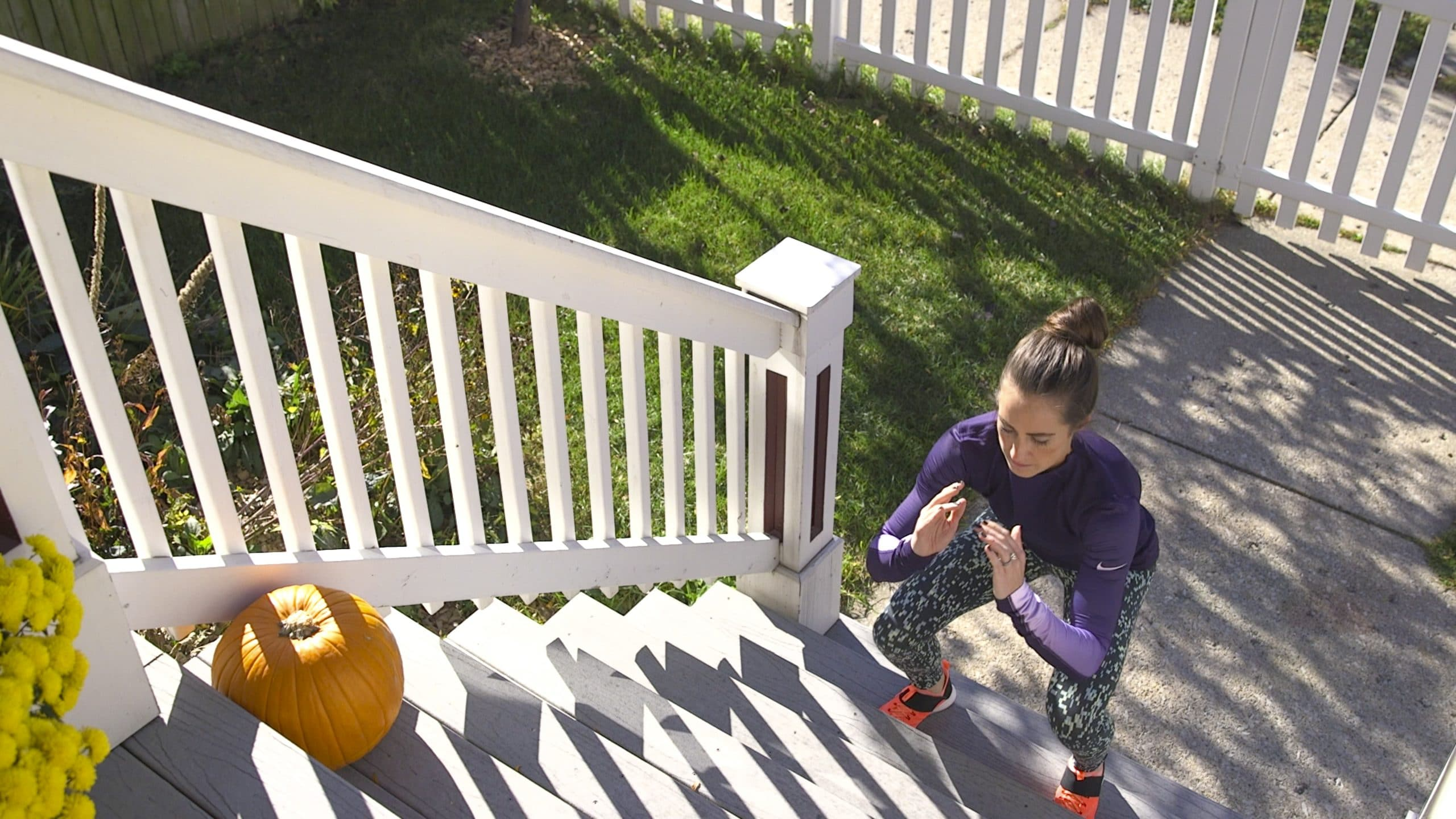 Nikki Metzger HIIT exercise routine on a stairway in the Autumn.